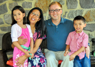 Photo of Rev. Tim Dalton with his wife Doris and two children Evangeline and Isaac