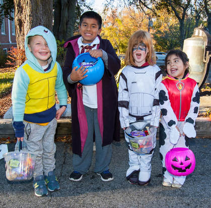 Children in costume at the 2016 Halloween party.